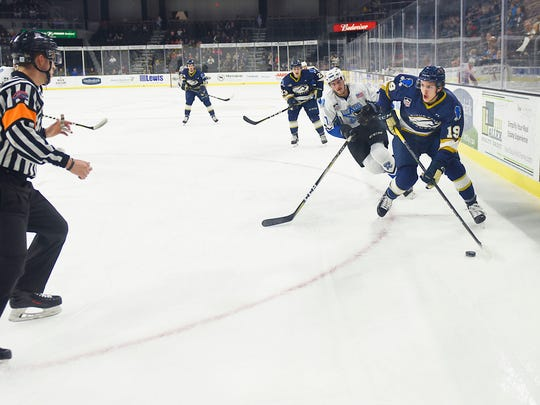 Stampede's Marko Reifenberger goes against Lincoln's Christian Krygier during game one of USHL playoff series Tuesday, April 17, at the Sioux Falls Arena.
