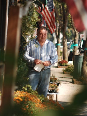 In this 2009 photo, Glen Carullo is shown outside his florist shop in Ho-Ho-Kus.