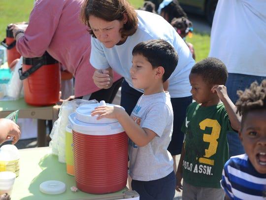 Children from HandsUp! Preschool enjoy lemonade at a fundraiser in 2016.