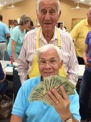 Bingo Committee member Dr. Herb Kern, awards Tommy