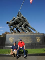 Harlan Hart, left, accompanies his father, Harold Hart of Raymond, to the U.S. Marine Corps Memorial in Washington, D.C. during Day Two of the Central Valley Honor Flight Sept. 16, 2014, to Washington, D.C. The elder Hart served in the Marines at Iwo Jima and remembers when the flag was raised, he said.