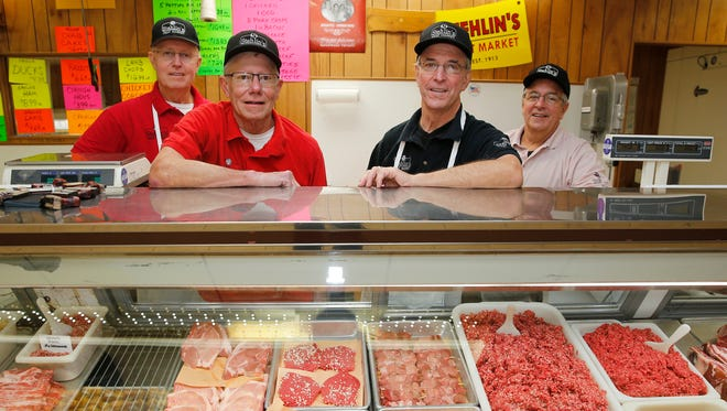 John Stehlin, left, Denny Stehlin, Ron Stehlin, and Dick Stehlin of Stehlin's Meat Market in Colerain Township Tuesday November 15, 2016.