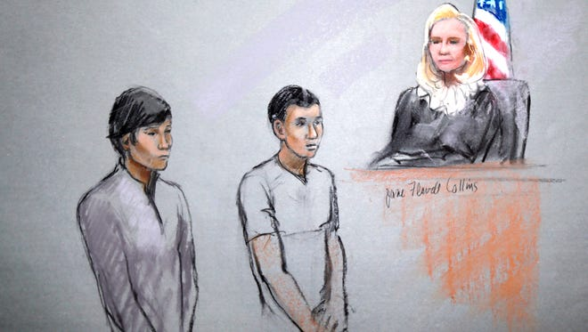 This courtroom sketch shows defendants Dias Kadyrbayev, left, and Azamat Tazhayakov appearing in front of federal Magistrate Marianne Bowler at the Moakley Federal Courthouse in Boston on May 1, 2013. The two were college friends of Boston Marathon bombing suspect Dzhokhar Tsarnaev.