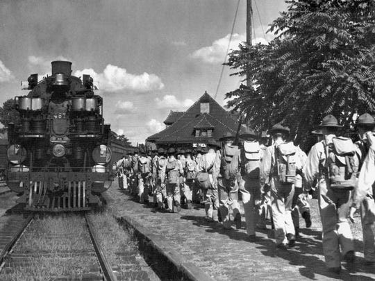Local Company G arrives at Lancaster's train depot for departure to Camp Shelby, Mississippi, in October 1940.