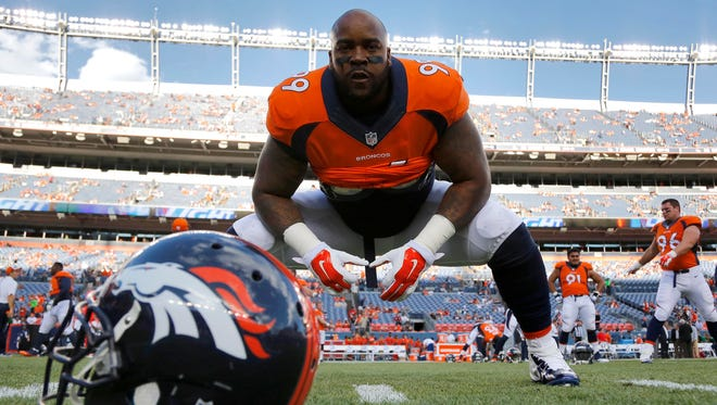 Denver Broncos defensive tackle Kevin Vickerson (99) stretches prior to Saturday's game. Vickerson had one tackle in his return from a hip injury against the Texans on Saturday.