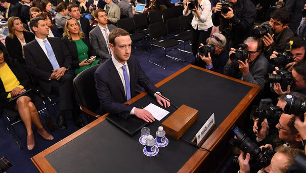 Facebook CEO Mark Zuckerberg arrives to testify...