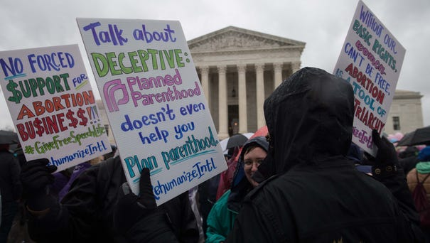 Anti-abortion activists demonstrated outside the...