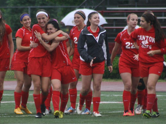 Canton players rejoice after defeating Churchill, 2-1.