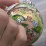Artists volunteer talent to hand paint ornaments. Buy one for $10 at Vienna Coffee House to help Mane Support.