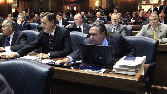 The Republican side of the Indiana House of Representatives are shown casting their votes on HJR-3 on third reading by a vote of 57-40 at the Indiana Statehouse in Indianapolis on Jan. 28, 2014. Rep. Jerry Torr, R-Carmel, foreground right, was among 11 Republicans voting no.