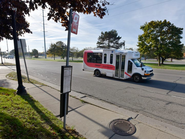 A SMART connector bus drives past the Beaumont Botsford