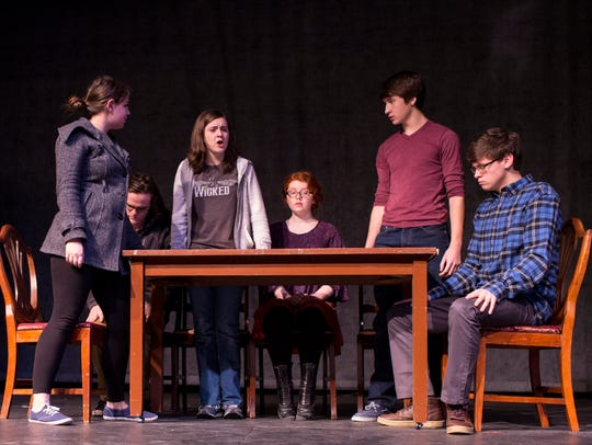 Students from the Governor's School rehearse the number