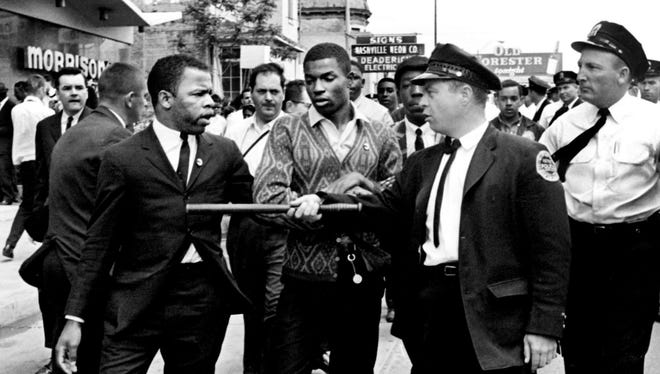 A police officer points his stick at Lewis, left, one of the leaders of the civil rights demonstrators at Morrison's Cafeteria on West End Avenue in Nashville, Tenn., on April 29, 1964.