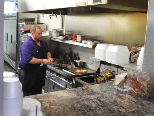 TGS Cupcakery and Bistro, owner Lee Partridge preps the grill at his family ran restaurant located at 3102 Kemp Blvd.