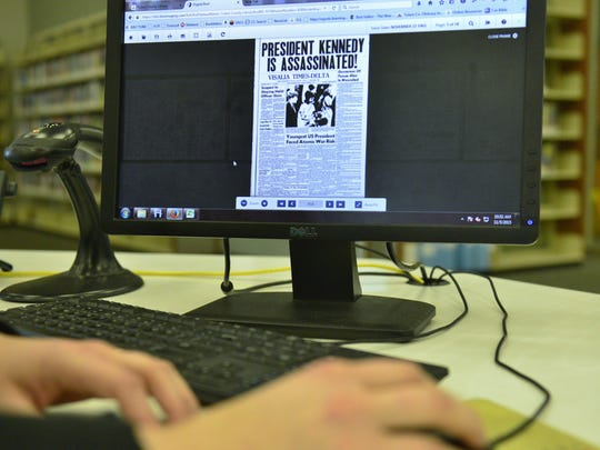 Computer screen shows digital image of Visalia Times-Delta issue.