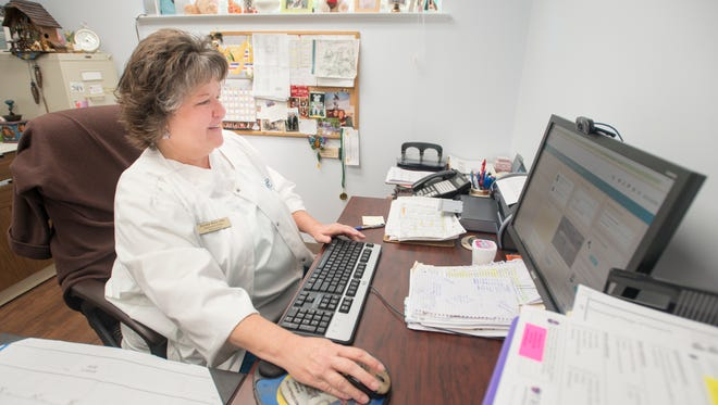 Executive director Deidre Reis works on her computer at the Homestead Village Retirement Community in Pensacola on Thursday, March 22, 2018.  Reis was named the 2017 administrator of the year by the Florida Assisted Living Association.