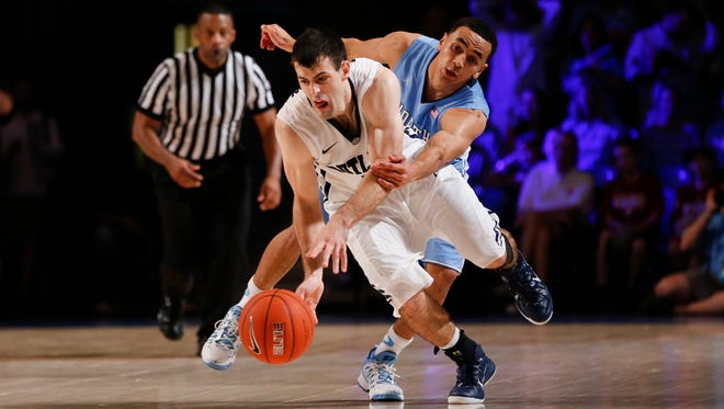 Butler guard Alex Barlow dribbles past North Carolina guard Marcus Paige during Wednesday's game at Atlantis Resort Imperial Arena.