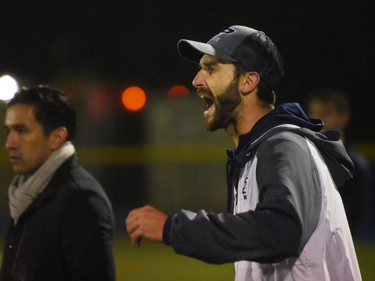 Paramus Head Coach Rob Auriemma encourages his team from the sidelines as they play against of Montville in the second half during the NJSIAA North 1 Group III boys soccer semifinal at Paramus High School on 11/5/18.