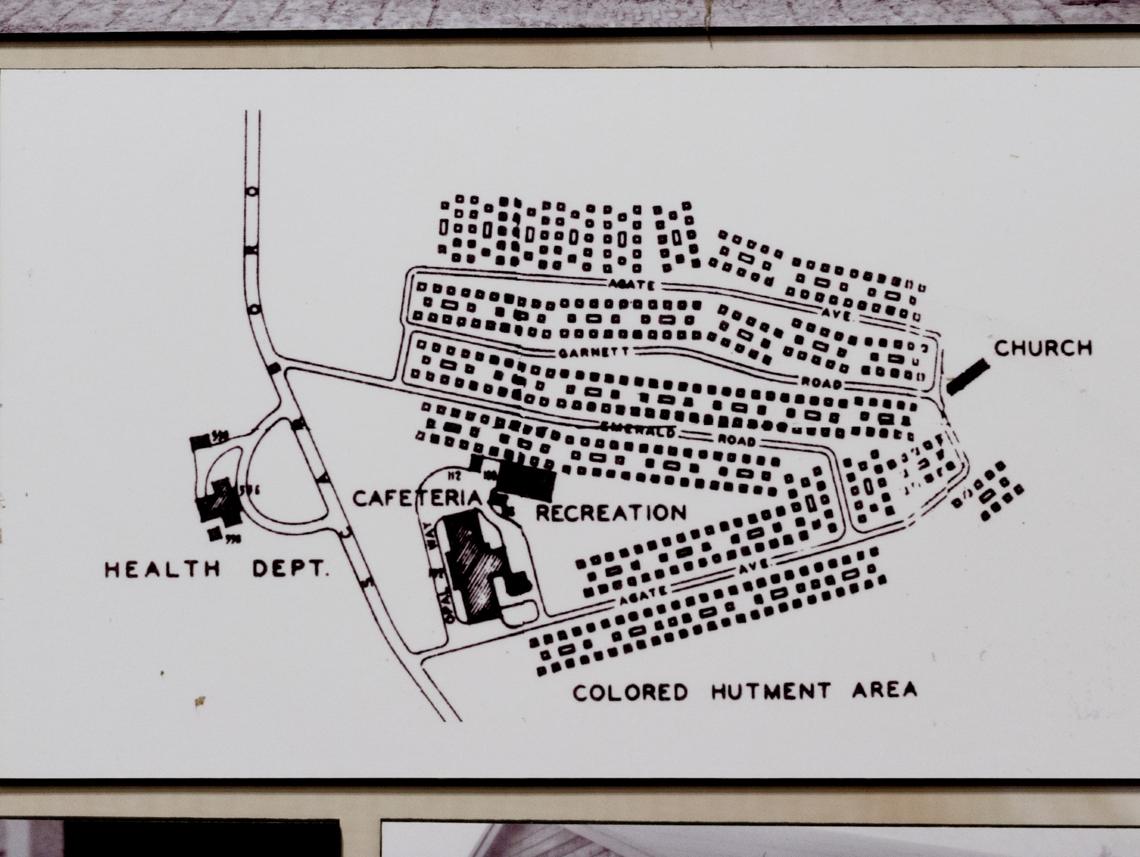 "A reprint of a map depicts the ""Colored Hutment Area"" of Oak Ridge where the African-American population once lived due to segregation."