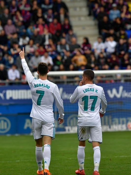 Real Madrid's Cristiano Ronaldo celebrates his second goal beside Lucas Vazquez after scoring during the Spanish La Liga soccer match between Real Madrid and SD Eibar at Ipurua stadium, in Eibar, northern Spain, Saturday, March 10, 2018. (AP Photo/Alvaro Barrientos)