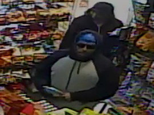 Police are looking for two suspects in connection with a robbery on East Market Street Dec. 18.