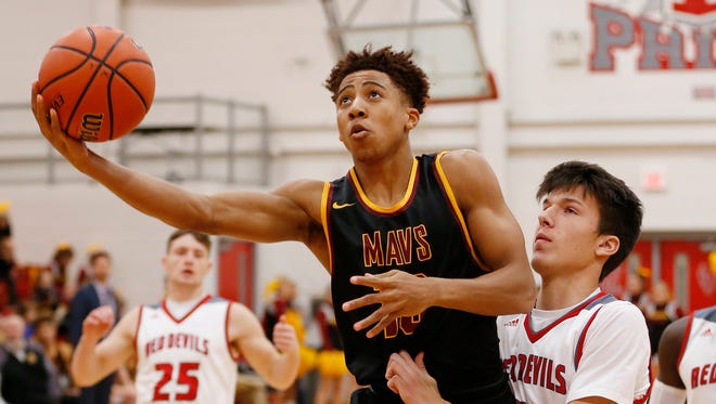 Robert Phinisee of McCutcheon gets past Matt Krause of West Lafayette for a shot Wednesday, November 22, 2017, in West Lafayette. McCutcheon defeated West Lafayette 61-60.