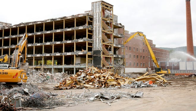Demolition crews continue tearing down the old Corning Hospital on Tuesday.