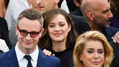 Marion Cotillard, center, is flanked by Nicolas Winding