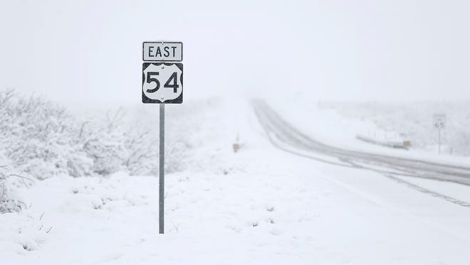 US-54 remained covered in snow in the early hours of Sunday morning.
