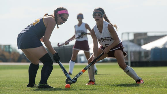 Greencastle's Logan Yaukey, left, battles it out for the ball with Shippensburg's Allie Holtry during a field hockey game at Shippensburg on Tuesday, Sept. 20, 2016. Greencastle defeated Shippensburg 2-1.