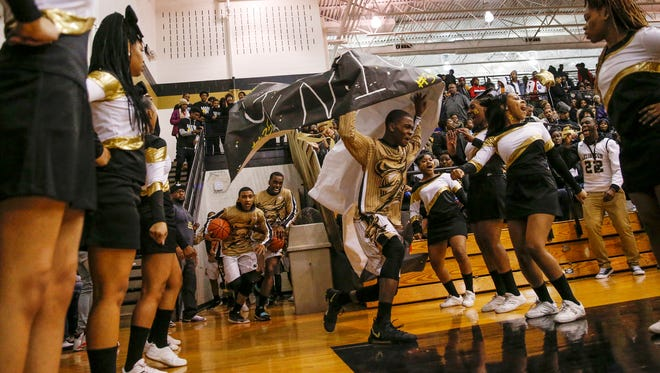 The Arlington Golden Knights take the court to face off against rivals Broad Ripple Rockets at Arlington High School on Friday, Feb. 9, 2018.
