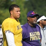 Alcorn State assistant head coach and quarterbacks coach Fred McNair, middle, helped guide John Gibbs Jr., left, to success as his position coach.