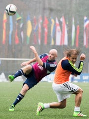 New FIFA President Swiss Gianni Infantino, left, shoots the ball during a friendly soccer match at the home of FIFA in Zurich, Switzerland, Monday, Feb. 29, 2016.