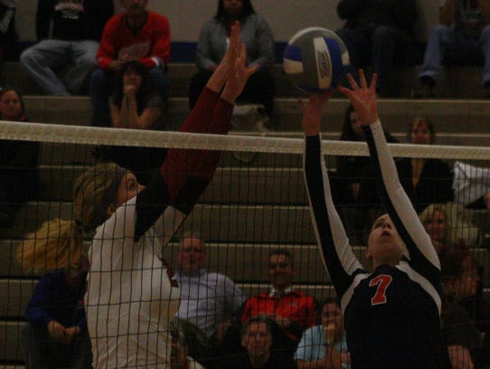 Franklin's Payton Miloser tries to tip the ball over