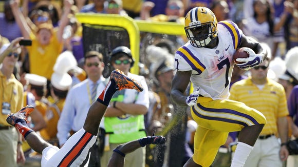 Gerald Herbert/AP LSU running back Leonard Fournette runs past Auburn defensive back Blake Countess for a TD during Saturday?s game. He ran for a career-high 228 yards and three TDs on 19 carries. LSU running back Leonard Fournette (7) runs past Auburn defensive back Blake Countess (24) on a touchdown run in the first half of an NCAA college football game in Baton Rouge, La., Saturday, Sept. 19, 2015. (AP Photo/Gerald Herbert)