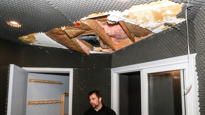 Mass Giorgini, owner of Sonic Iguana recording studio, stands underneath a heavily damaged ceiling that was caused from flooding overhead  that happened to his studio in Lafayette.