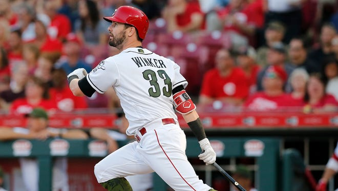 Cincinnati Reds right fielder Jesse Winker (33) doubles to center field in the third inning of the MLB National League game between the Cincinnati Reds and the Colorado Rockies at Great American Ball Park in downtown Cincinnati on Wednesday, June 6, 2018.