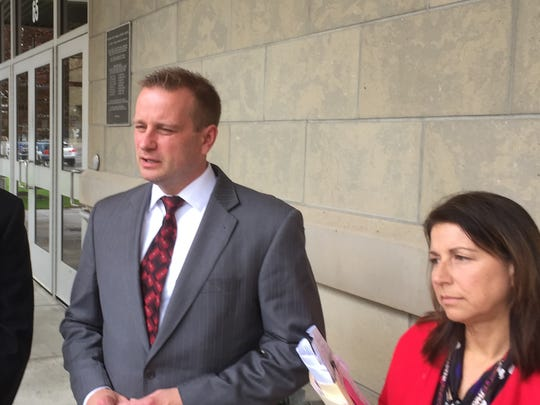 Chief Assistant District Attorney Michael Korchak, left; District Attorney Steve Cornwell, center; and Assistant District Attorney Lisa Bideaux, right, discuss the sentencing of James Starnes.