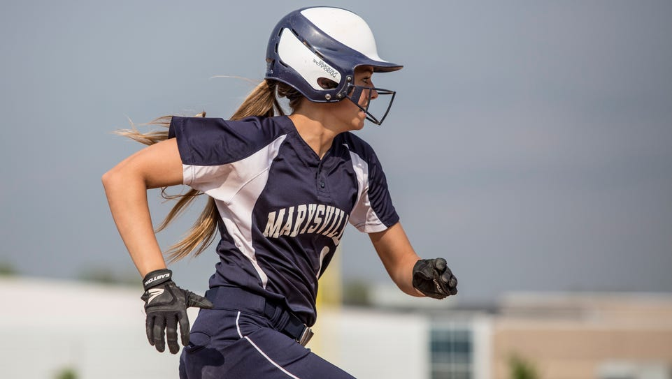 Marysville's Carley Agostino runs to first during a
