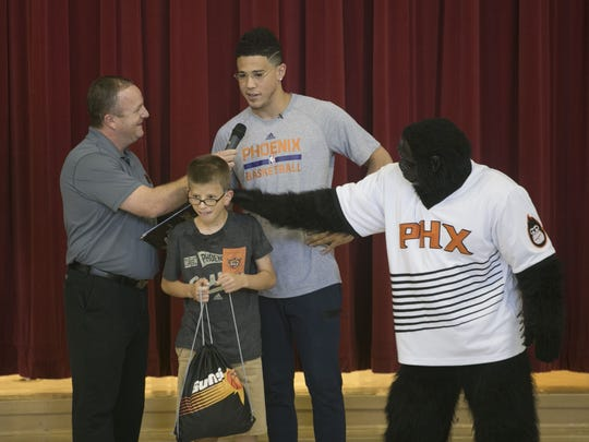 Devin Booker announces that Noah Smith, 11, will be