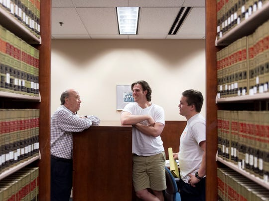 Tom Winston, left, talks with classmates Carter Pack, center, and Trey Buckley during a break in their studies at the University of Tennessee's College of Law on Monday, May 8, 2017. Winston, who is 63, is starting a new career in law after with 40-years in the healthcare industry.