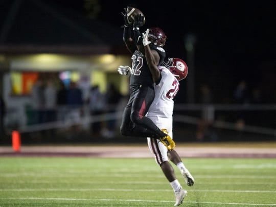Fulton's Jashaun Fenderson makes the catch while defended by Oak Ridge's Adarius Simpson on Friday, October 27, 2017.