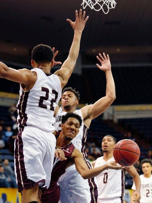 Troy guard Wesley Person (3) passes around Texas State guard Nijal Pearson (22) during the Sun Belt Conference NCAA college basketball championship game in New Orleans, Sunday, March 12, 2017. (AP Photo/Gerald Herbert)