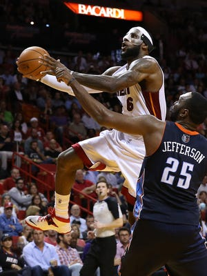 LeBron James drives to the bucket past Al Jefferson for two of his 61 points.