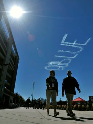 "When skywriting that read ""Go Blue,"" appeared above Spartan Stadium, a campaign was launched that has already raised $36,000 for cancer awareness."