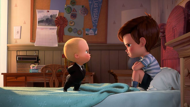 """Boss Baby, voiced by Alec Baldwin, tries to convince Tim, voiced by Miles Bakshi, that they must cooperate in  """"The Boss Baby."""" The movie opens Thursday at Regal West Manchester Stadium 13, Frank Theatres Queensgate Stadium 13 and R/C Hanover Movies."""