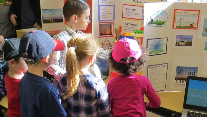 Liam Johnson shares his project about wind energy with younger students at Bataan Memorial Elementary Grade 3 Science Fair.