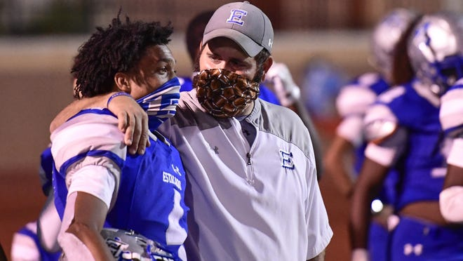 Estacado head coach Joe Cluley puts his arm around safety Anthony Hawkins (4) after the Matadors' game against Hereford on Sept. 18  at PlainsCapital Park at Lowery Field.