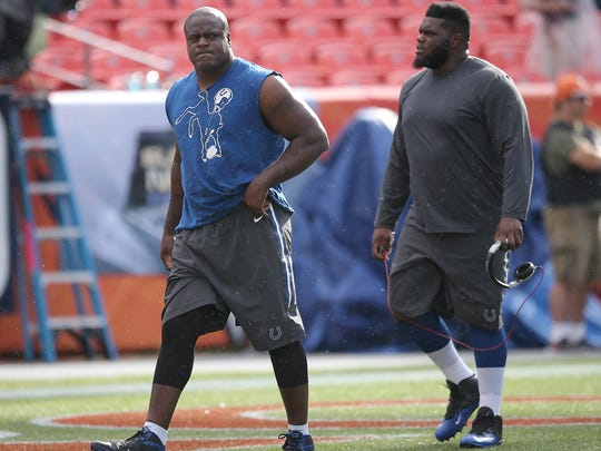 Indianapolis Colts Cory Redding warms up with Zach Kerr,right, prior to their game. The Indianapolis Colts play the Denver Broncos Sunday, September 7, 2014, evening at Sports Authority Field at Mile High in Denver CO.