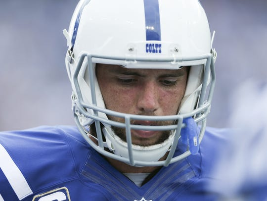 Colts quarterback Andrew Luck (12) looks downward after